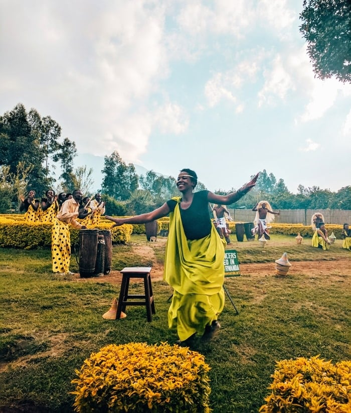 Woman dancing in gorilla trekking welcome ceremony in Volcanoes National Park Rwanda