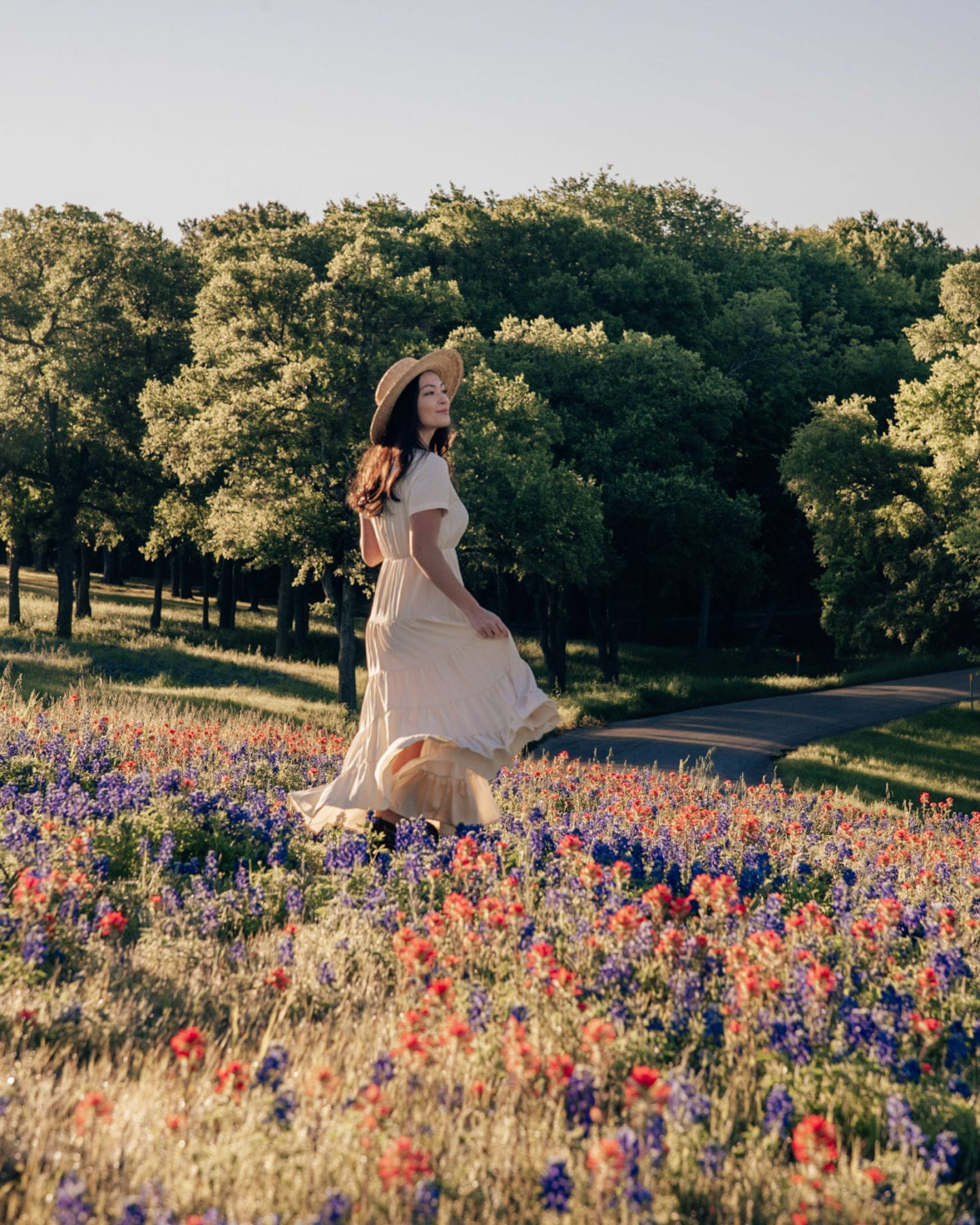 girl in bluebonnets and indian flowers