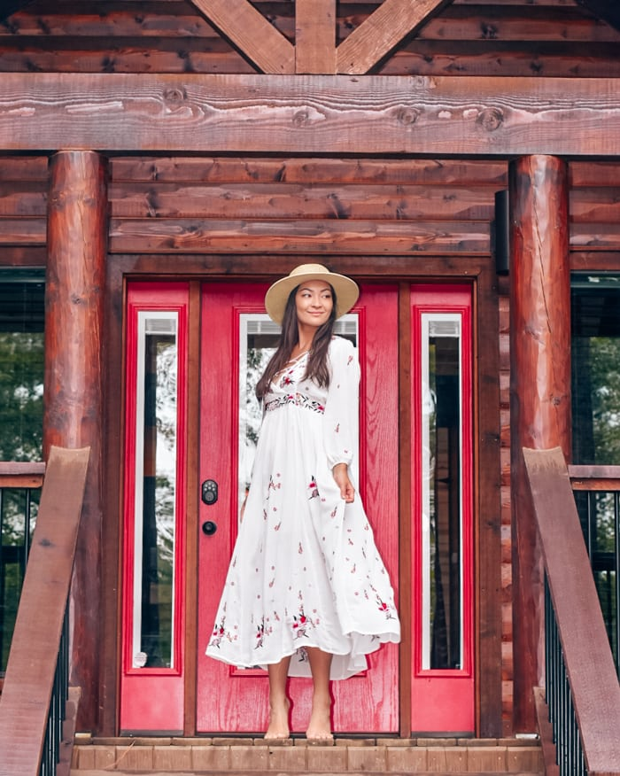 cabin entrance girl in white dress