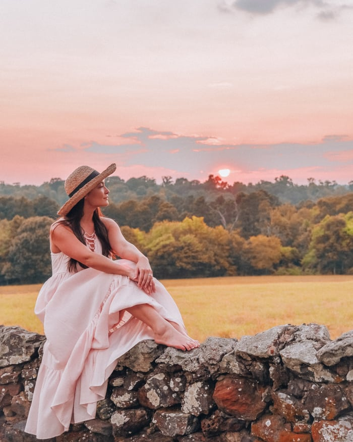 girl watching sunset in countryside
