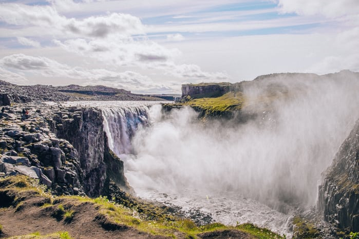 An Iceland itinerary stop at Dettifoss, a powerful waterfall.