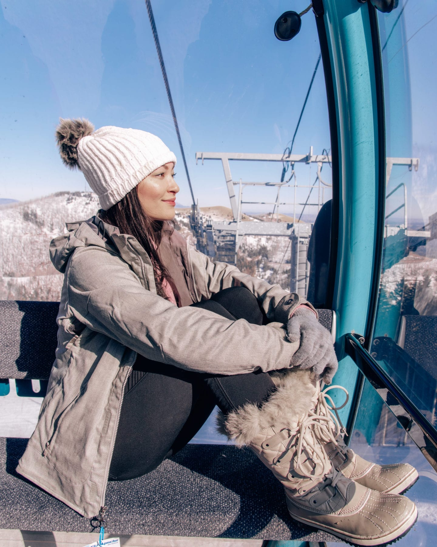 girl sitting in ski apache gondola sierra blanca views