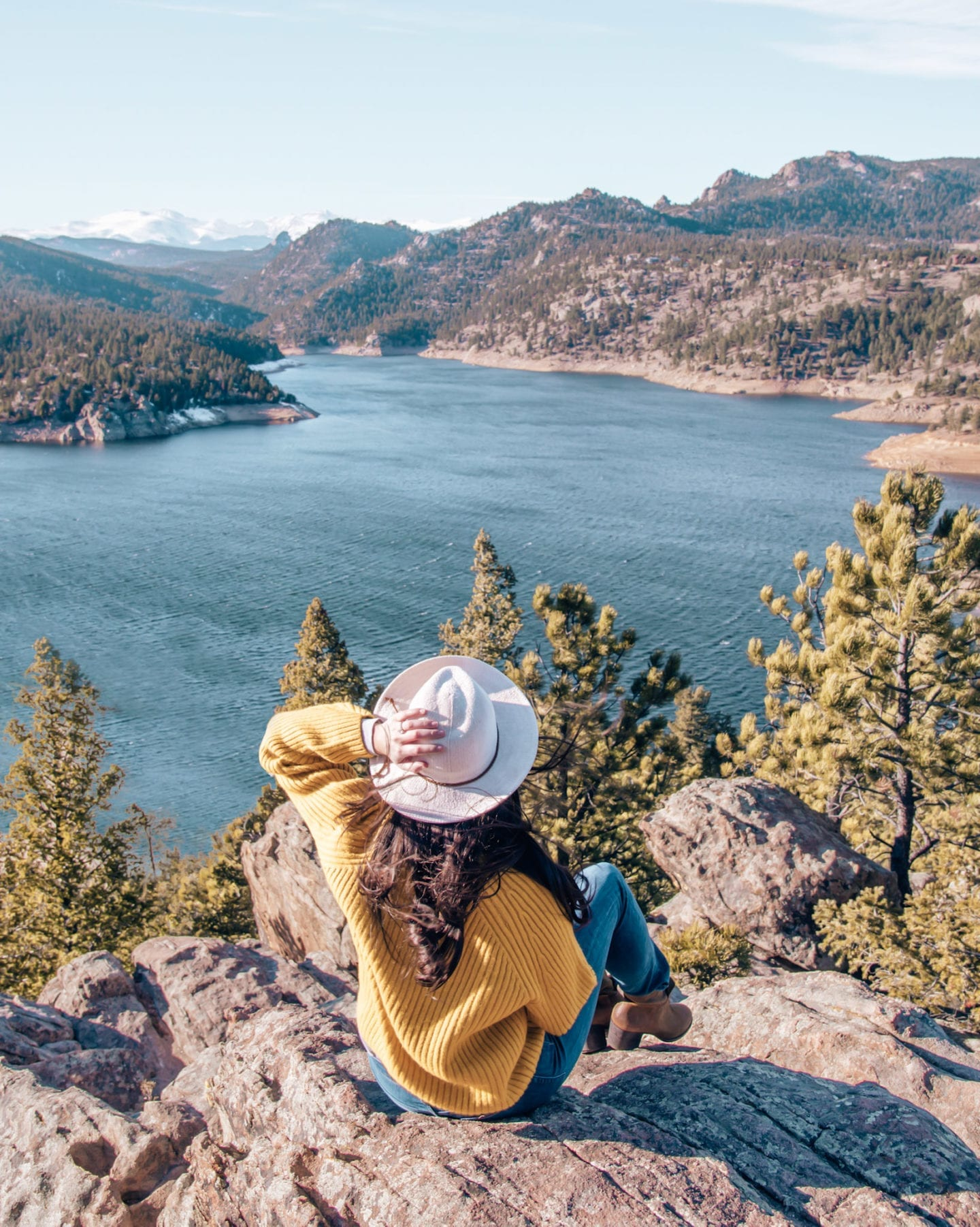 Girl looking down at Gross Reservoir in Boulder, CO