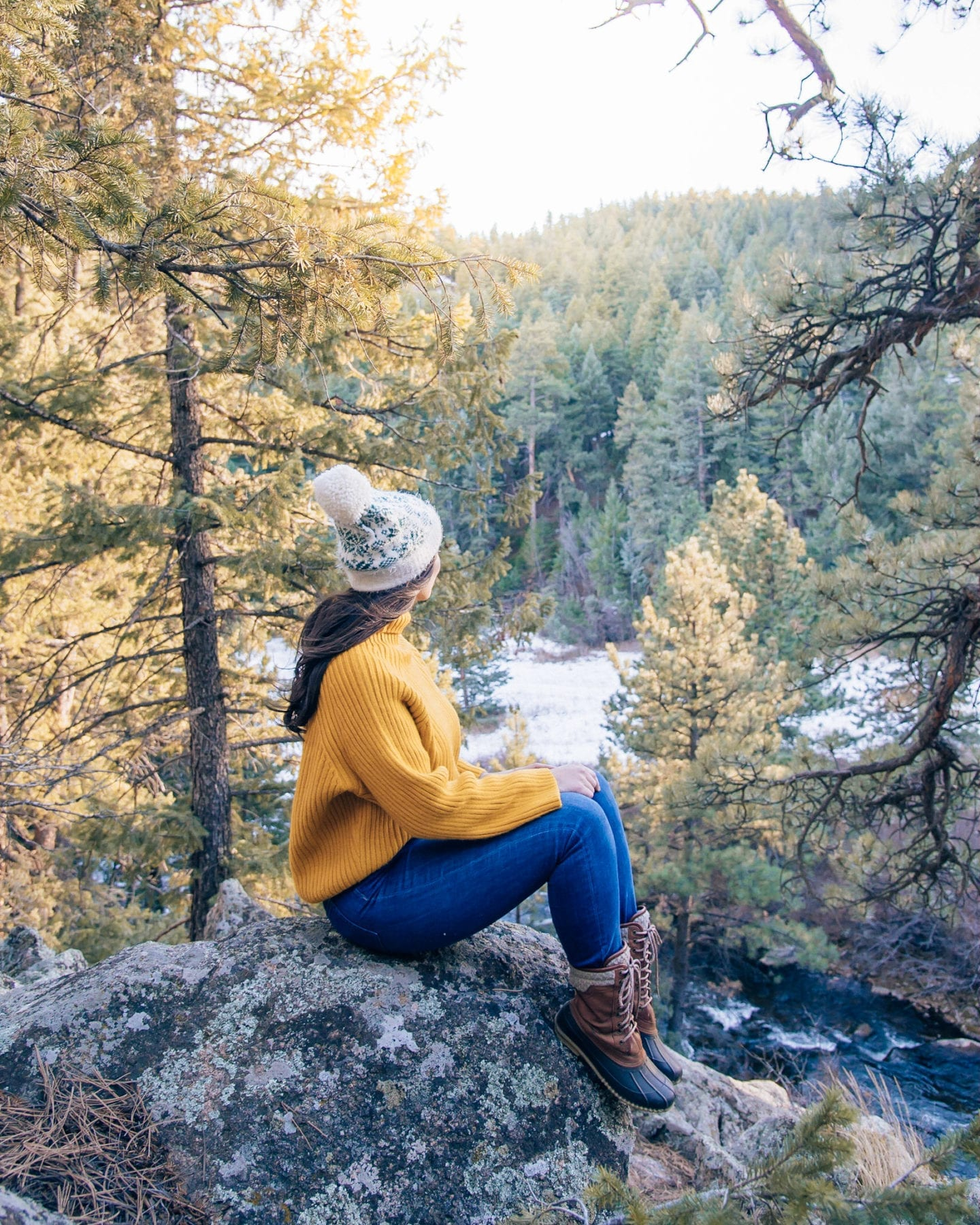 girl sitting on rock in forest