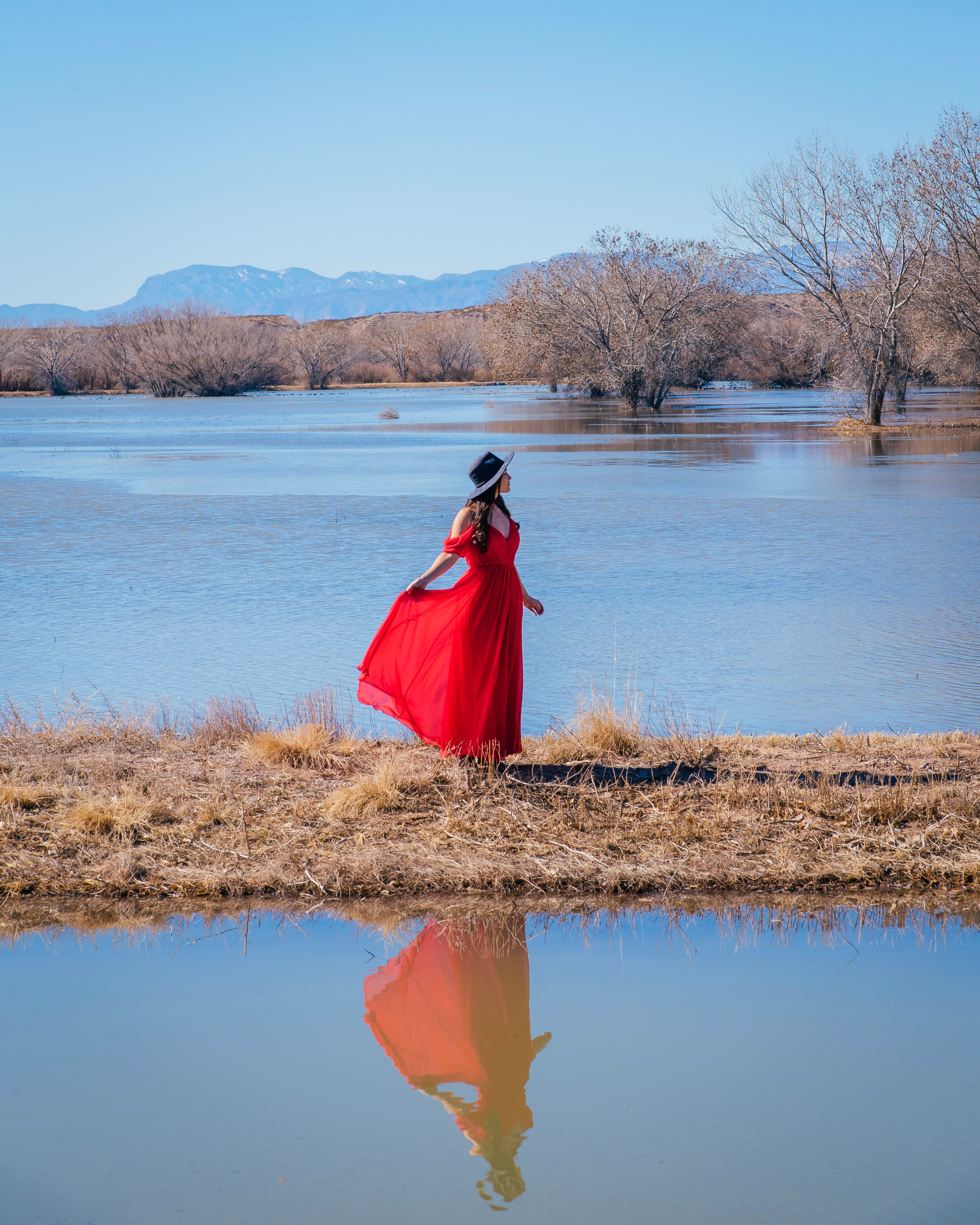 girl in red dress at bosque del apache