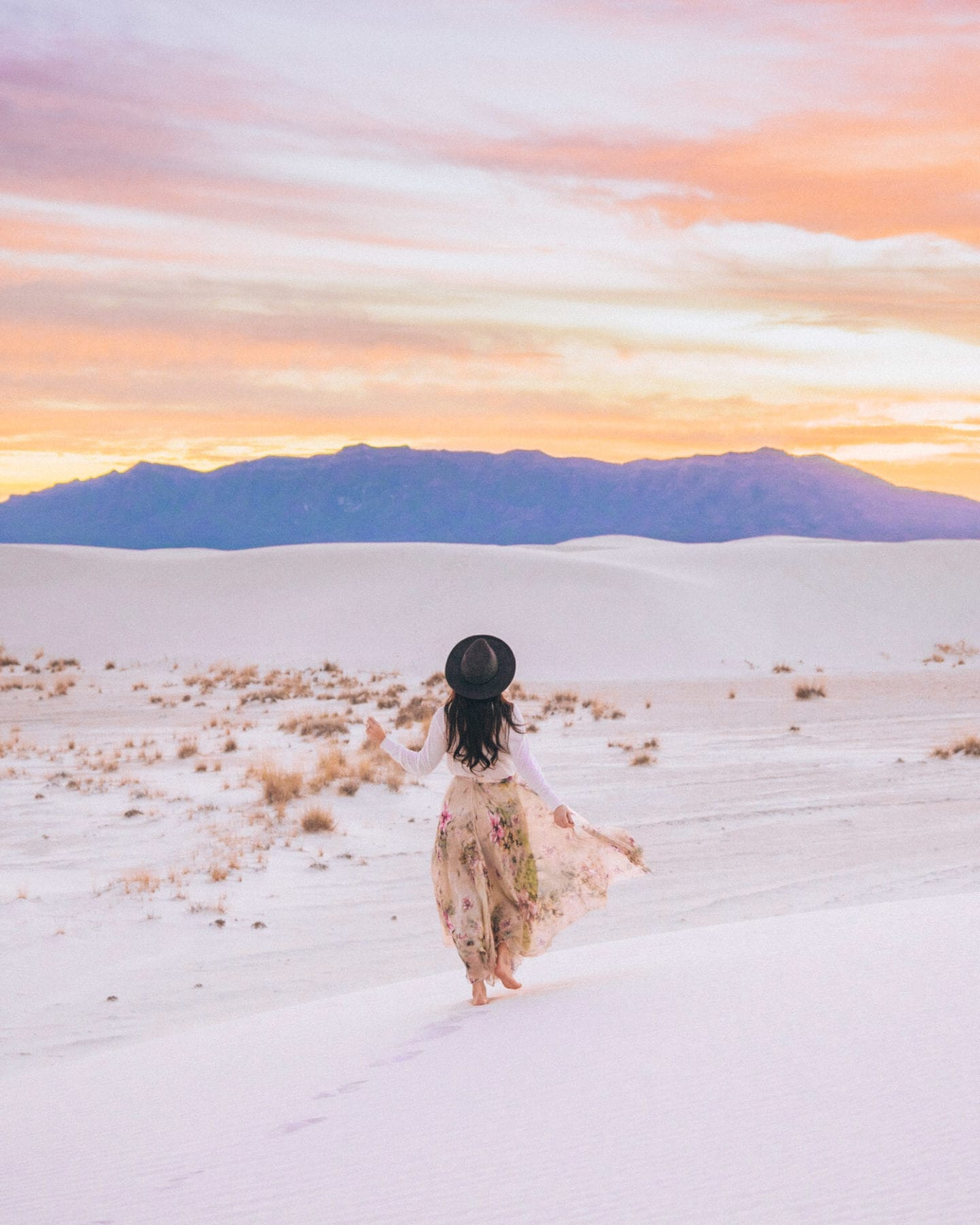 girl wearing skirt at white sands national monument at sunset