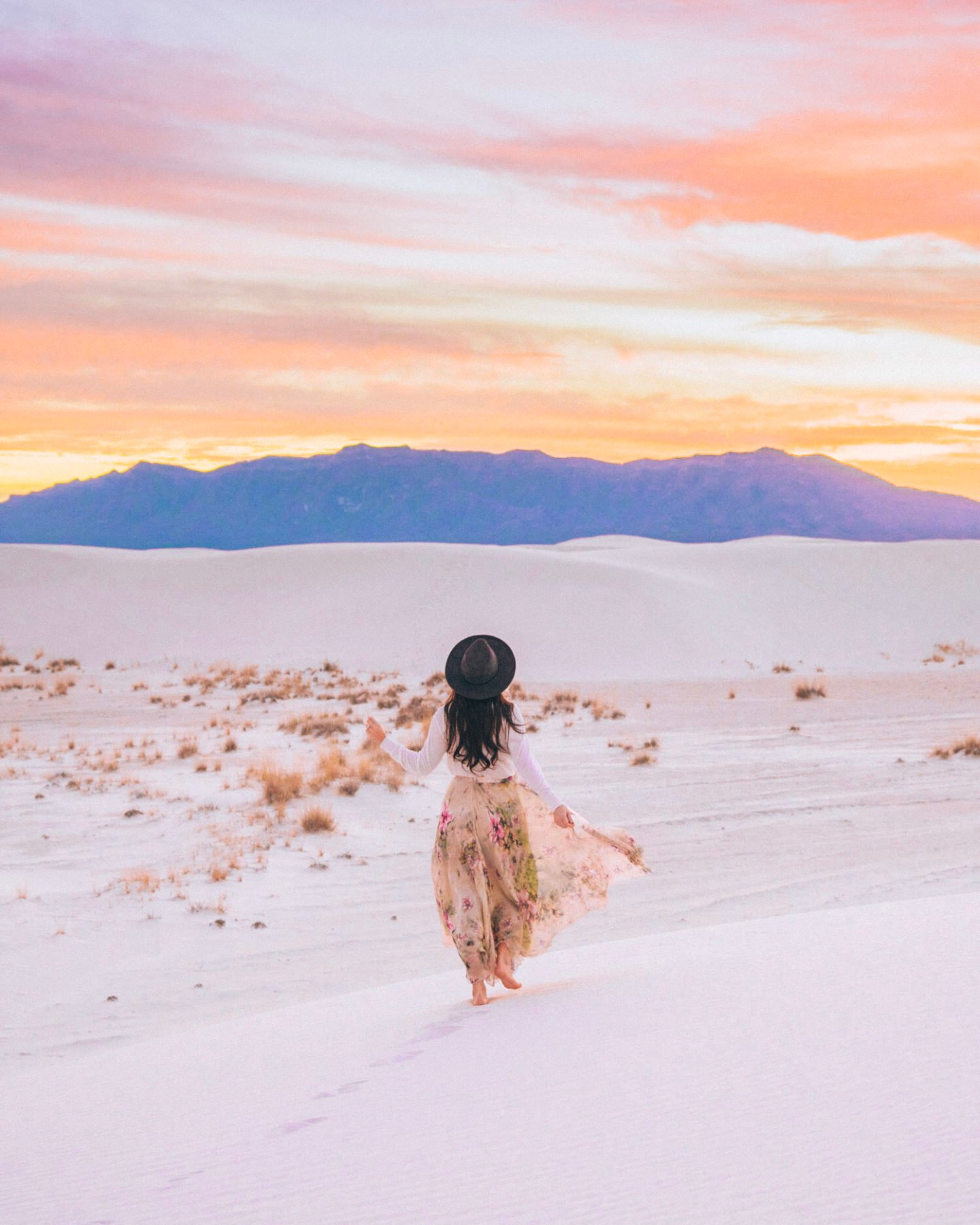 girl wearing skirt at white sands national monument at sunset