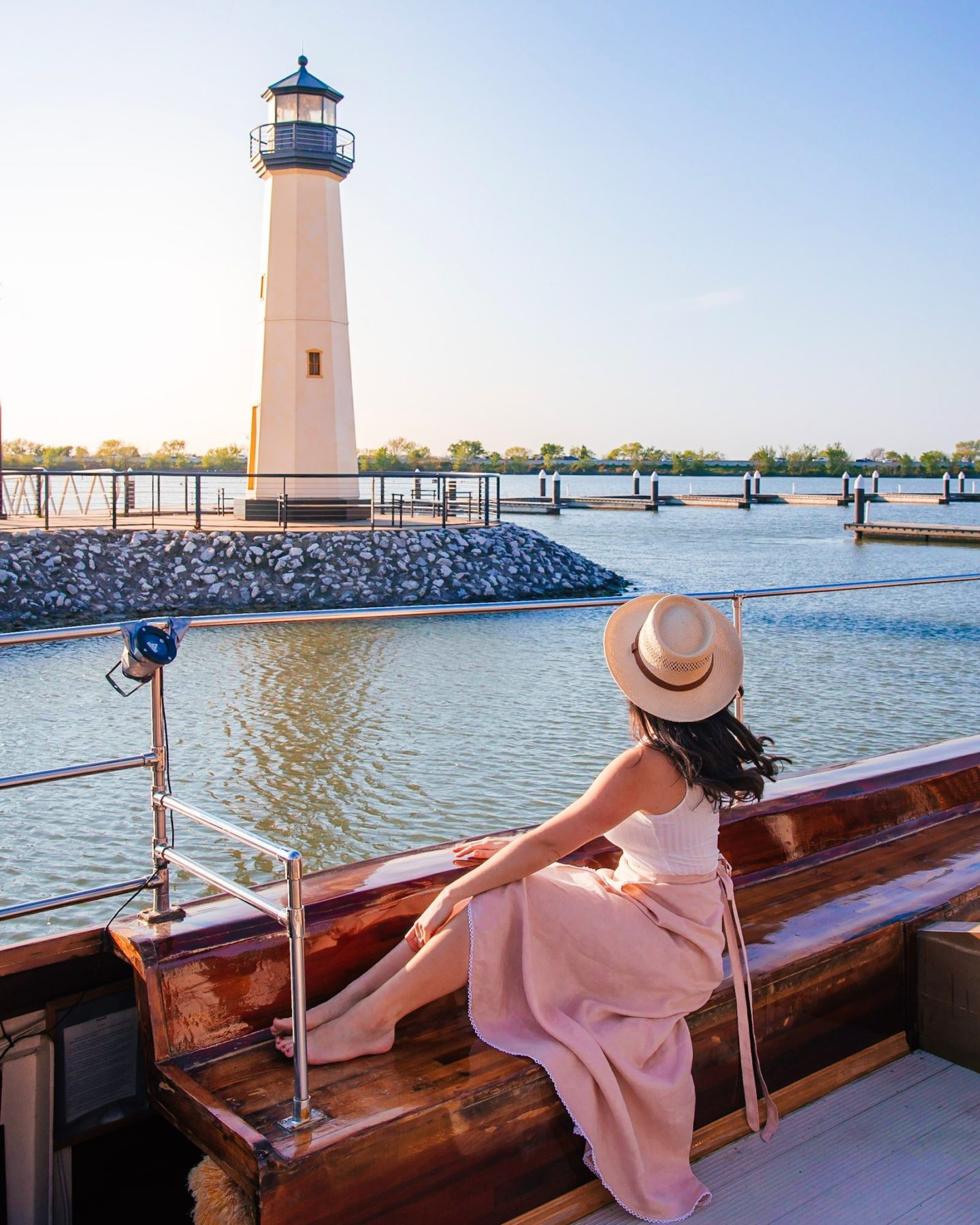 Girl on Sail with Scott in front of lighthouse in Rockwall Harbour