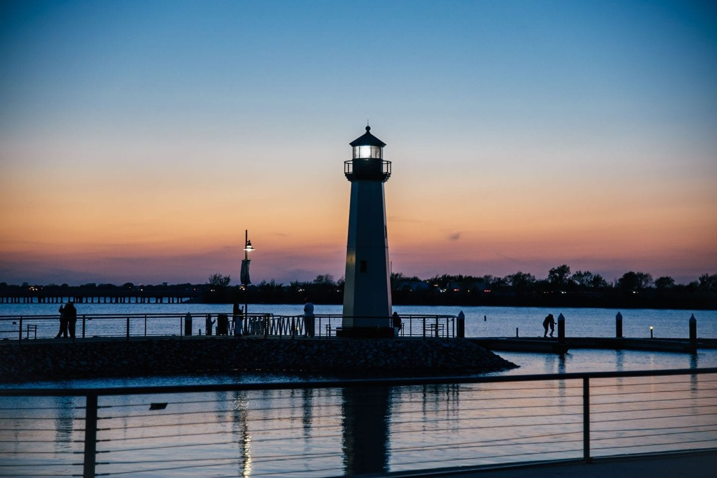 sunset on lake ray hubbard with lighthouse